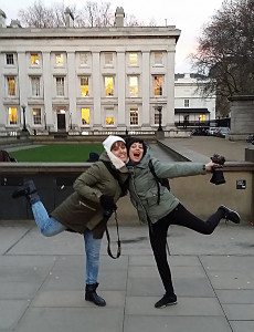 Two girls show off in front of the British Museum with a dance of joy