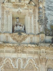 Pigeon perched on the head of the statue of St Peter in the Iglesia de San Pedro, Arcos de la Frontera, Andalusia